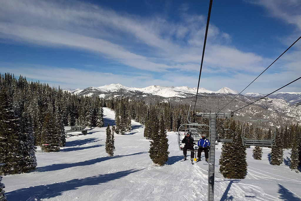 Two people on a ski lift